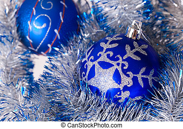 Blue balls - Blue celebratory balls and tinsel close up
