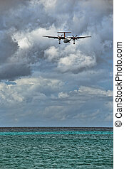 Plane Landing in Saint Maarten Coast, Dutch Antilles - Plane...