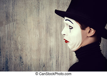 dramatic - Portrait in profile of a male mime artist...