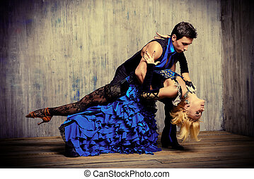 passionate dance - Two beautiful dancers perform the tango....