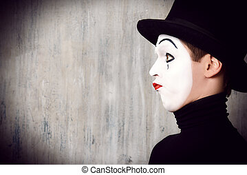 top hat - Portrait in profile of a male mime artist...