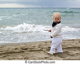 1 year old baby girl at the sea
