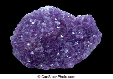 amethyst crystal stone in a black isolated background