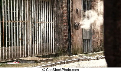 dirty deserted back alleyway 4 - Steam coming from outlet in...