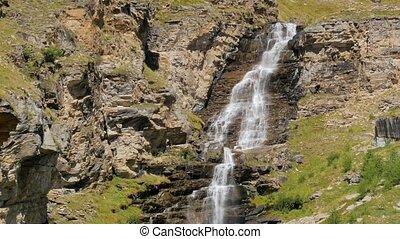 alpine waterfall - beautiful waterfall in the alps