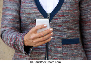 Business female hand holding cell phone - Close up business...