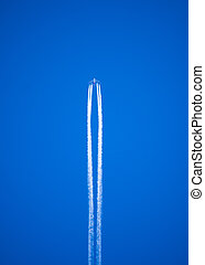 jet trails - vapor trails left by a high flying jet