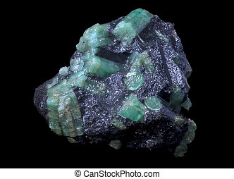 emerald stone in a black isolated background