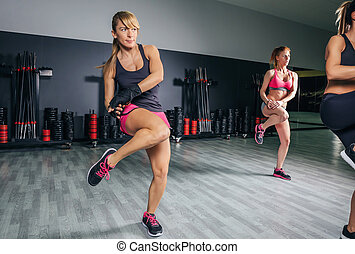 Women training boxing in a fitness center - Group of...
