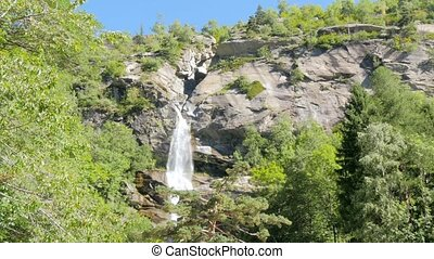 alpine waterfall - beautiful waterfall in the alps