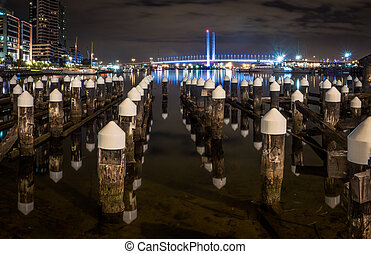Melbourne's docklands - Looking over an old pier towards the...