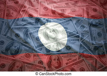 colorful waving laotian flag on a american dollar money background