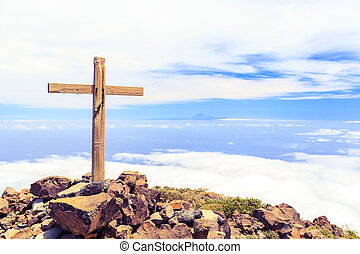 Christian cross on mountain top, rocky summit, beautiful...