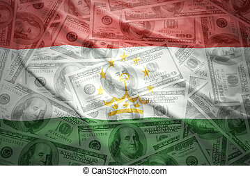 colorful waving tajik flag on a american dollar money...