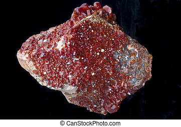 vanadinite stone in a black isolated background