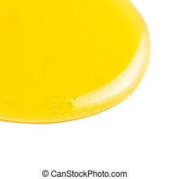 Honey flowing on a white background macro