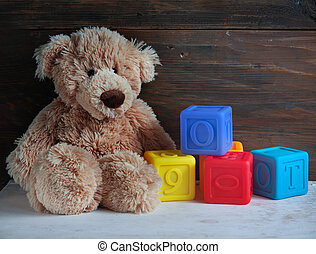 Teddy bear - Teddy Bear toy and cubes on rustic wood...