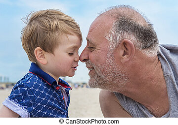 grandfather and grandson on the beach - Grandfather and...