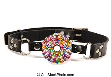 Donut ball gag, isolated on white background.