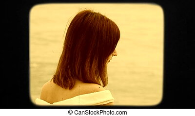 Young Pretty Dark-Haired Woman In White Dress Posing By Sea...