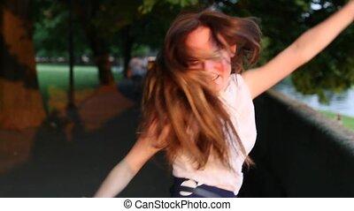 Young beautiful girl happy dancing
