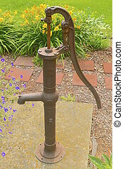 Old hand pump - An old hand pump with a cylindrical pipe...