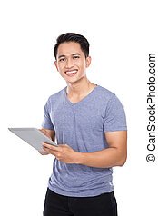Young Asian man holding a digital touch screen tablet computer on white background.
