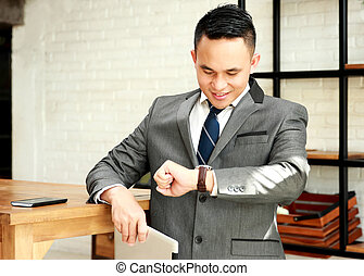 businessman looking at his watches waiting for appointment with client