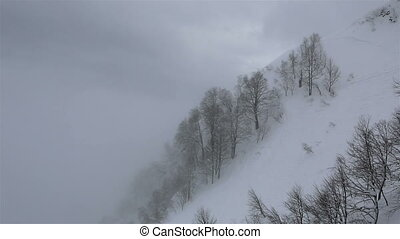 Beautiful mountain peaks of Caucasus Mountains in the fog