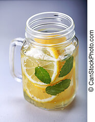 a glass of fresh lemon infused water