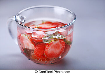 a glass of fresh strawberry infused water