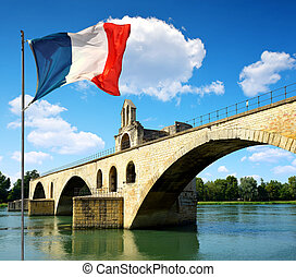Avignon, France - Pont Saint-Benezet with French flag in...