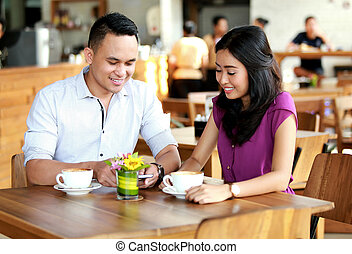 happy couple dating at coffee shop - portrait of happy...