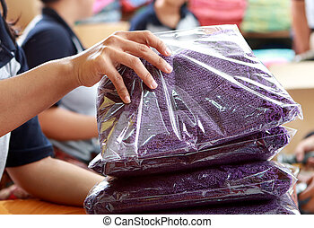 sorting process of clothing products at textile factory