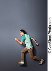 young man running in the air - full body portrait of young...
