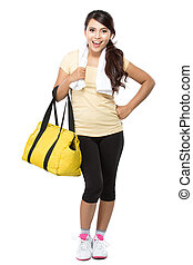 Happy fit young woman with gym bag standing ready for fitness exercise