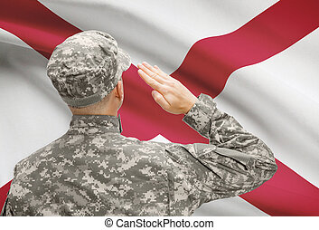 Soldier saluting to US state flag series - Alabama