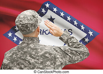 Soldier saluting to US state flag series - Arkansas -...