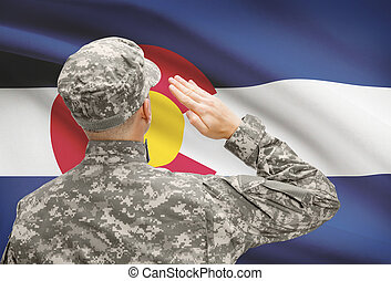 Soldier saluting to US state flag series - Colorado