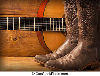 Country music with guitar and cowboy boots