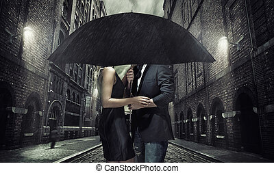Adorable couple under the umbrella - Adorable couple under...