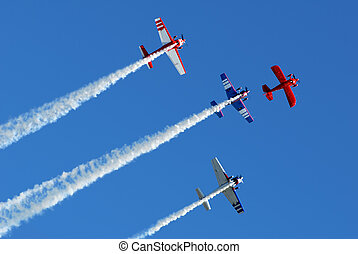 Stunt Planes in Formation - Stunt aircraft flying in...