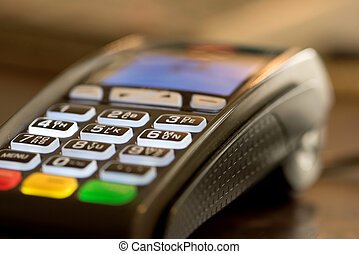 Credit card reader machine - Close up image of credit card...