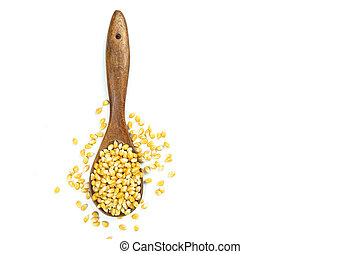 Yellow grain corn in wooden spoon isolated on white...