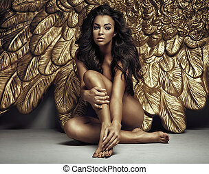 Portrait of a cute angel with gold wings - Portrait of a...