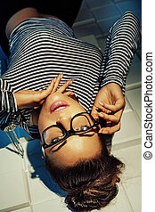 Alluring woman lying on the floor