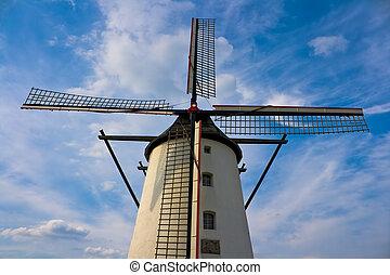 Windmill against nice blue sky