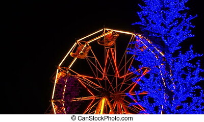 Bright Ferris Wheel With  Bright Lights Spinning At Night