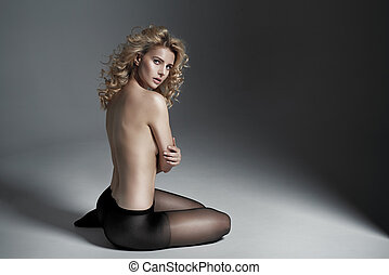 Half nude blond woman wearing black tights - Half nude blond...