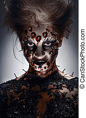 Pierced grin. - A creepy halloween makeup of a witch with a...